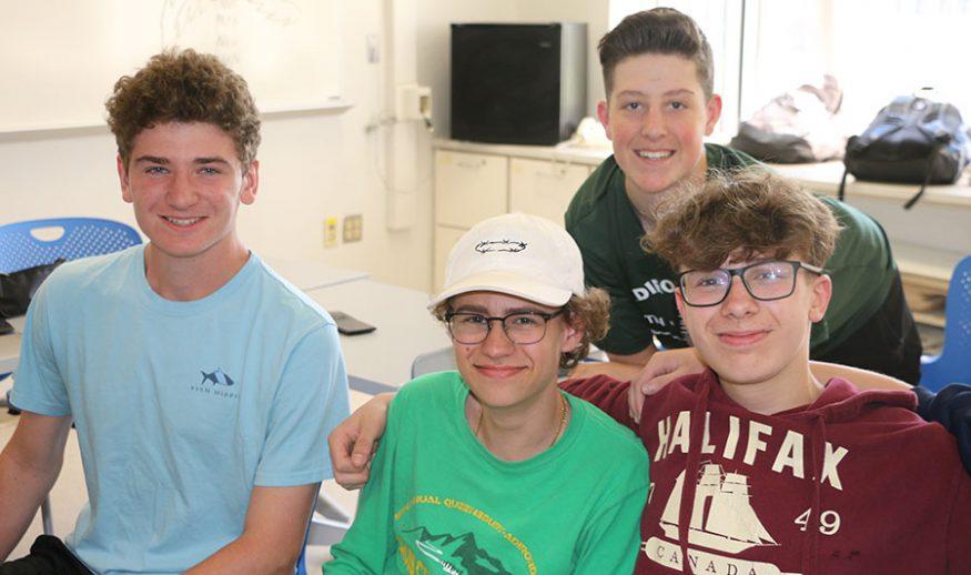 Four QHS male students