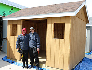 QHS students in front of their shed
