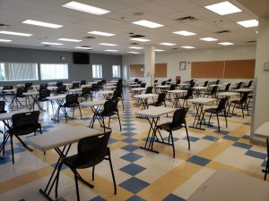 Physically distanced cafeteria with seating