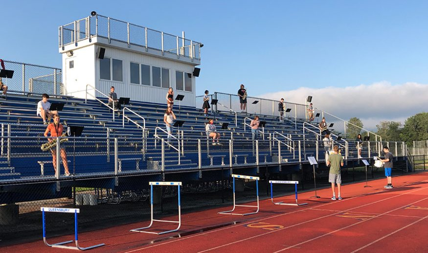 Music practice on the bleachers outside
