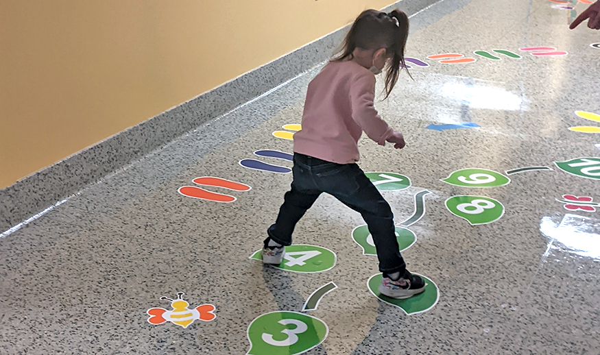 QES student participates in gym class in a QES hallway
