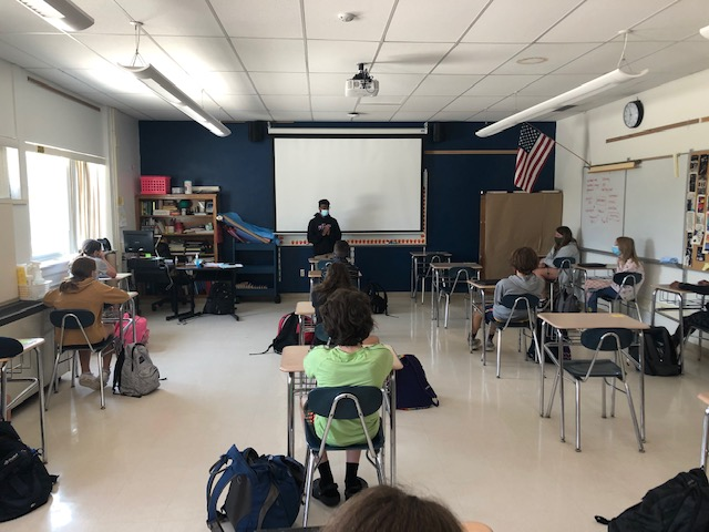 Jimar McMaster standing in front of the class at QMS