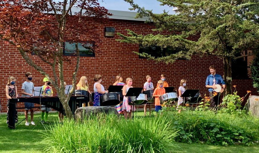 Photo of steel band students performing outside QMS