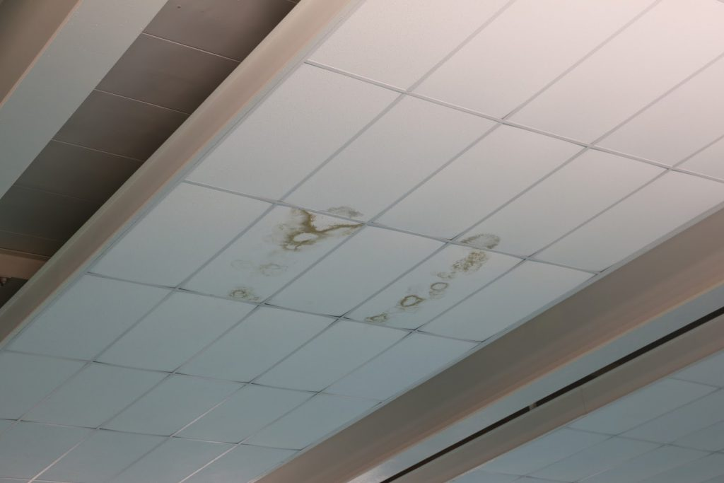 A photo of a water stained pool ceiling