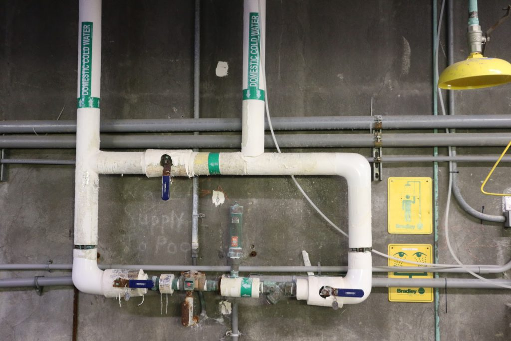 A photo of an old pool pipe system