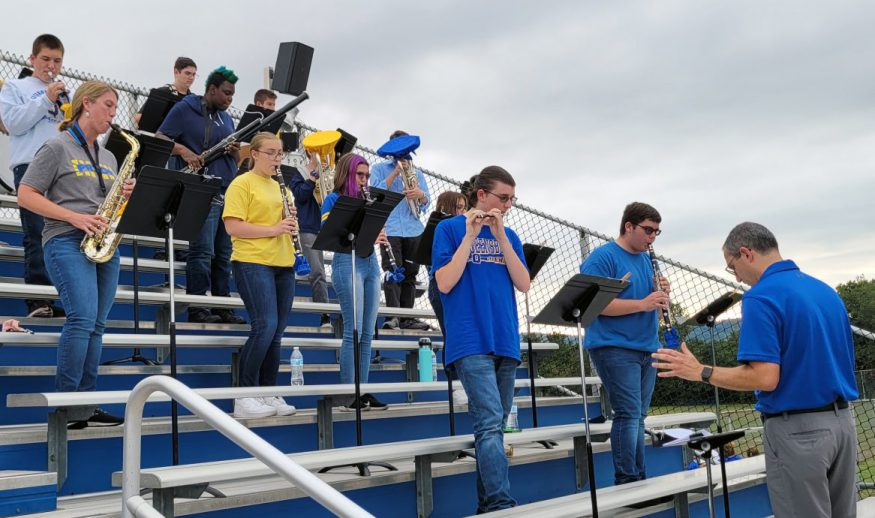 A photo of the QHS Jazz Band performing in the stands